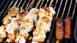 White meat grilled on the barbeque grill at market. Horizontal Shot.
